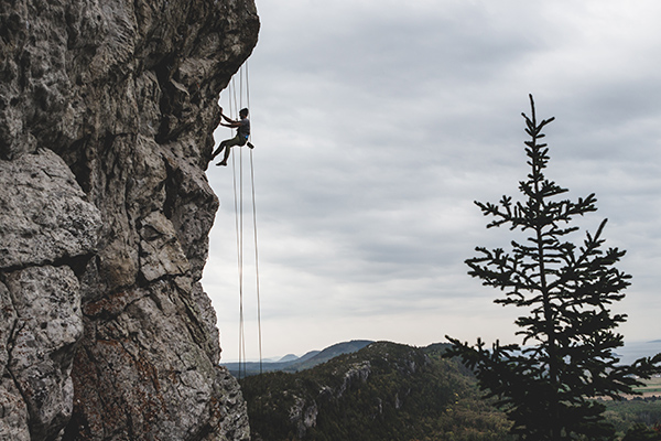 man climbing a mountain, much like the mountain of overcoming sex addiction
