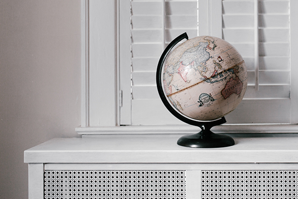 a globe in a white room