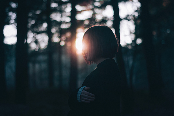 woman backlit by the sun